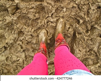 muddy wellies Wellington boots music festival fashion woman's legs