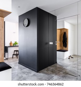 Mudroom with modern mirrored wall open to kitchen