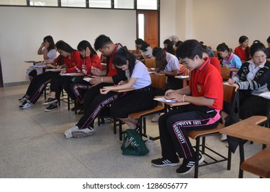 """""""Mueang Loei District, Loei Province / Thailand - January 16th, 2019 : Loei Rajabhat University students attending classroom activities, sitting and doing task in the classroom"""