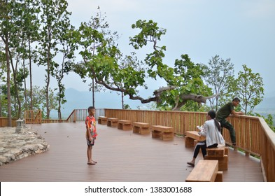 Mueang Loei District, Loei Province / Thailand - March 19, 2019 : A family, mother, father, and son, taking photo on a wooden platform at a viewpoint on Phu Buddho, a famous local attraction in Loei