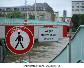 Muelheim, NRW, Germany 07-15-2021 Extreme high flood of the river Ruhr, sign warning for flooding