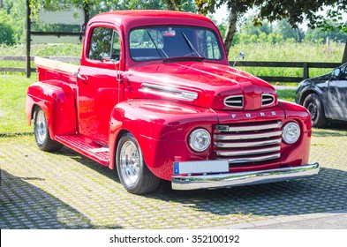 MUELHEIM RUHR, NRW, GERMANY - JUNE 04, 2015:An old renovated red Ford vintage pickup in a parking lot.