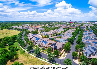 Mueller District Solar panel community aerial drone view above real estate suburb homes and houses in booming economy of Austin Texas USA 2019 renewable energy and sustainable standards