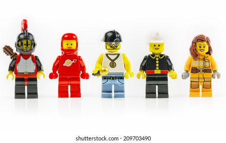 Muenster, Germany - June 18th 2014: A group of five various lego mini characters isolated on white. Lego is a popular line of construction toys manufactured by the Lego Group.