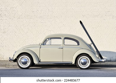 MUENSTER, GERMANY - MARCH 3, 2011: Early 60s VW Beetle, or informally the VW Bug, with ski rack parked in a street. The VW Beetle manufactured and marketed by German automaker VW from 1938 until 2003.