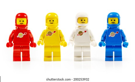 Muenster, Germany - November 24th 2013: A group of four various astronaut lego mini characters isolated on white. Lego is a popular line of construction toys manufactured by the Lego Group.