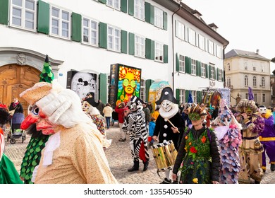 Muensterberg, Basel, Switzerland - March 12th, 2019. Carnival marching group with colorful costumes
