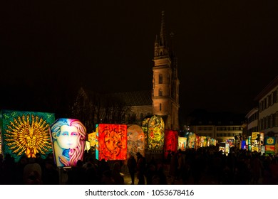Muensterplatz, Basel, Switzerland - February 20th, 2018. Basel carnival. Beautiful illuminated lanterns in front of the Basel minster