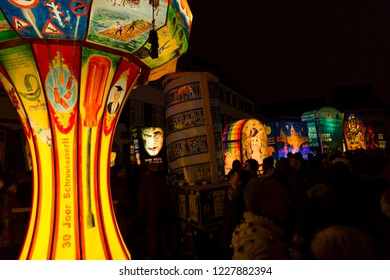Muensterplatz, Basel, Switzerland - February 20th, 2018. Basel carnival. People watching the many illuminated carnival lanterns