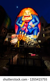 Muensterplatz, Basel, Switzerland - March 12th, 2019. A hand painted colorful illuminated carnival lantern displayed on the cathedral square