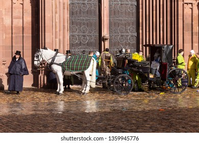 Muensterplatz, Basel, Switzerland - March 13th, 2019. A carnival horse carriage parked in front of the cathedral