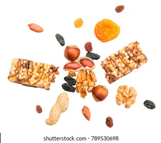 Muesli bar bursting with ingredients: nuts, raisins, apricot. Healthy eating concept.