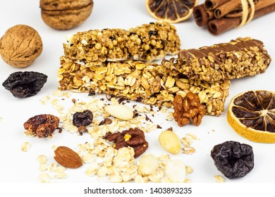 Muesli bar on a white background. Healthy food. Protein diet. Healthy sweetness. Oatmeal and dried fruits.