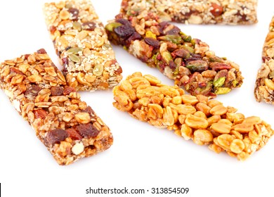 Muesli bars with different nuts isolated on white background.