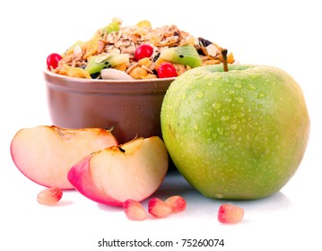 Muesli in bowl with apples isolated on white