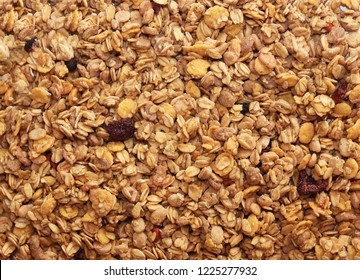Muesli breakfast background. Organic crunchy homemade granola cereal with oats and berries. Oatmeal granola texture, top view, flat lay.