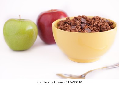 Muesli breakfast with chocolate , red apple and green apple