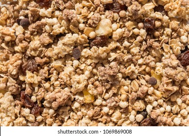 Muesli breakfast with oatmeal cereals raisins. Close up view of crunchy granola, muesli pile with banana slices and chocolate. Can be used as a background. Top view. Healthy eating. proper nutrition.