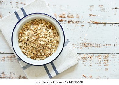 Muesli cereal mix in a vintage bowl . Wooden background, copy space