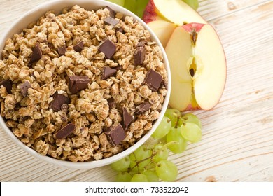muesli chocolate on wooden background