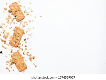 muesli cookies sprinkled with pumpkin seeds, isolated on a white background, selective focus. Top view, copy space.