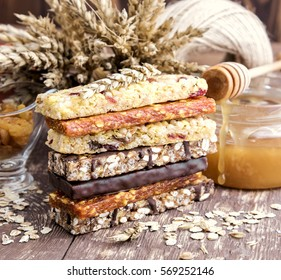 Muesli and Dried fruit bars Healthy breakfast Honey Red apple Wheat   Wooden background