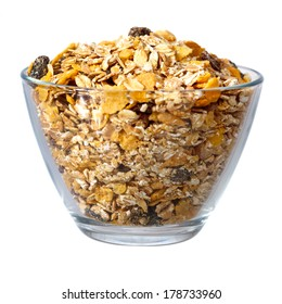 Muesli in glass bowl isolated over white background