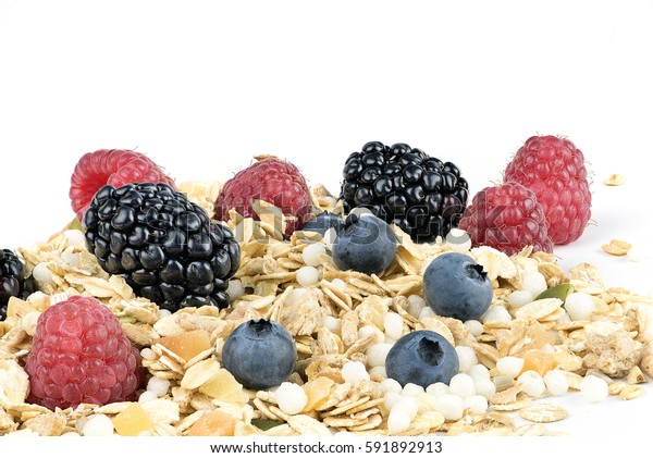 Muesli and mixed berries on white background