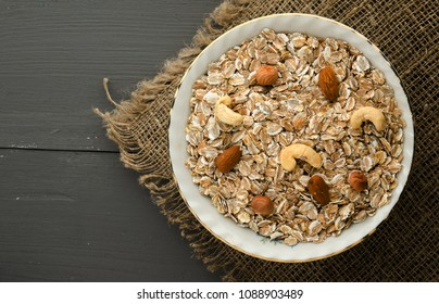 muesli with nuts. muesli on a wooden table. muesli top view . healthy food