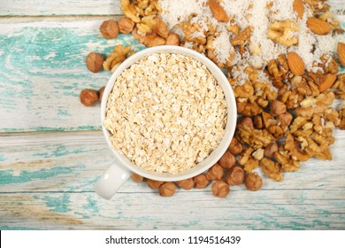 muesli with nuts and products for muesli are on the table