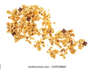 Muesli pile with chocolate isolated on white background, top view. Crunchy granola.