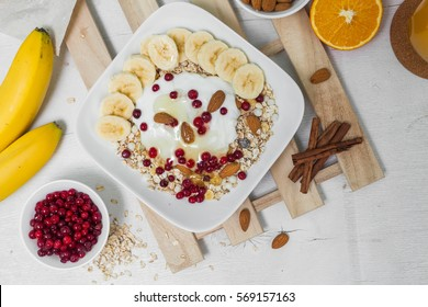 Muesli with yogurt, almond, banana and fruits, healthy breakfast