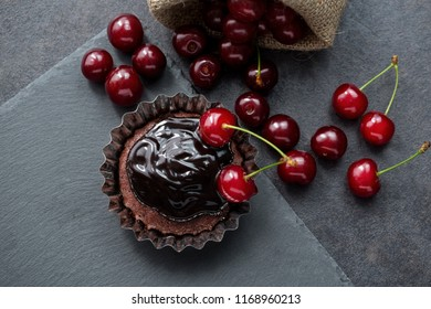 Muffin, chocolate, cherry, rustic style background concept