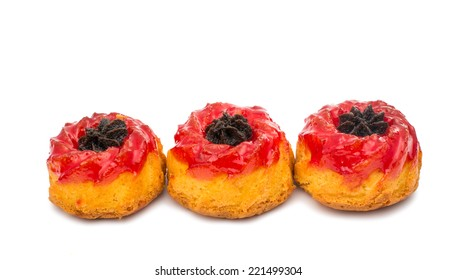muffin with jam on a white background