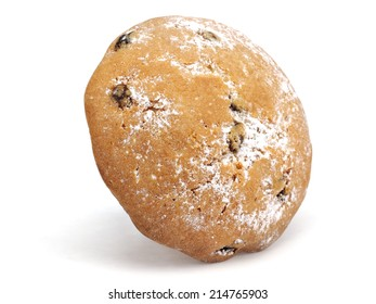 Muffin with raisins on a white background