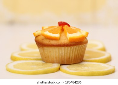 Muffin surrounded by lemons