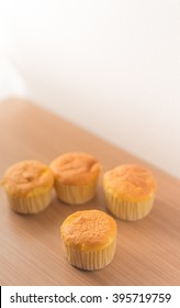 muffin top on Wood Table Background