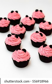 muffins cupcakes with pink cream and black Minnie Mouse ears
