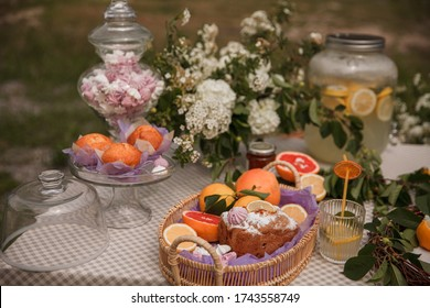 Muffins in a fruit basket. Picnic in the Park on the green grass with fruit,