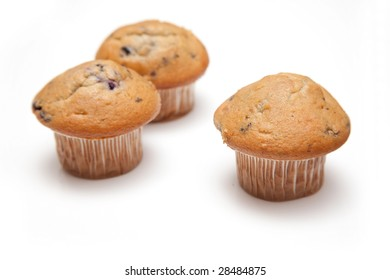 Muffins isolated on a white studio background.