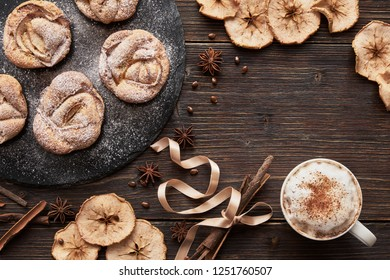 muffins on black plate, cappuccino cup