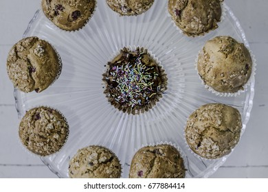 Muffins on glass cake-stand, view from above.