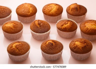 Muffins in paper forms on a mirrored background. Homemade baked