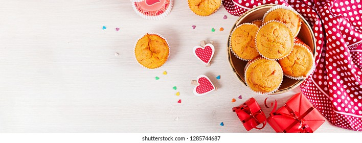Muffins with pumpkin. Cupcakes with Valentine's Day decor. Flat lay. Banner. Top view.