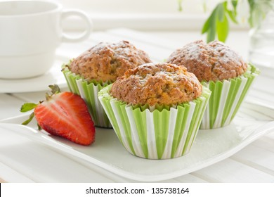 Muffins with strawberries and bananas.