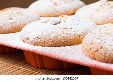 Muffins with a sugar powder in a silicon mold