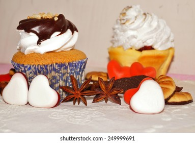 muffins with whipped cream and chocolate sauce and sweet hearts