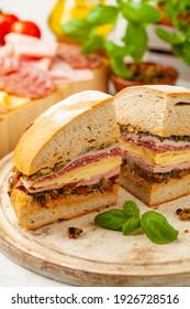 Muffuletta. Sandwich with cheese, ham and olive paste. A traditional recipe in New Orleans. Front view.