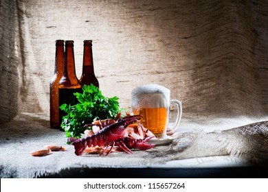 Mug of beer and boiled cancer with vegetable