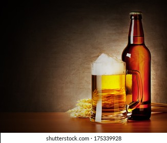 Mug of beer and a bottle with spikelets